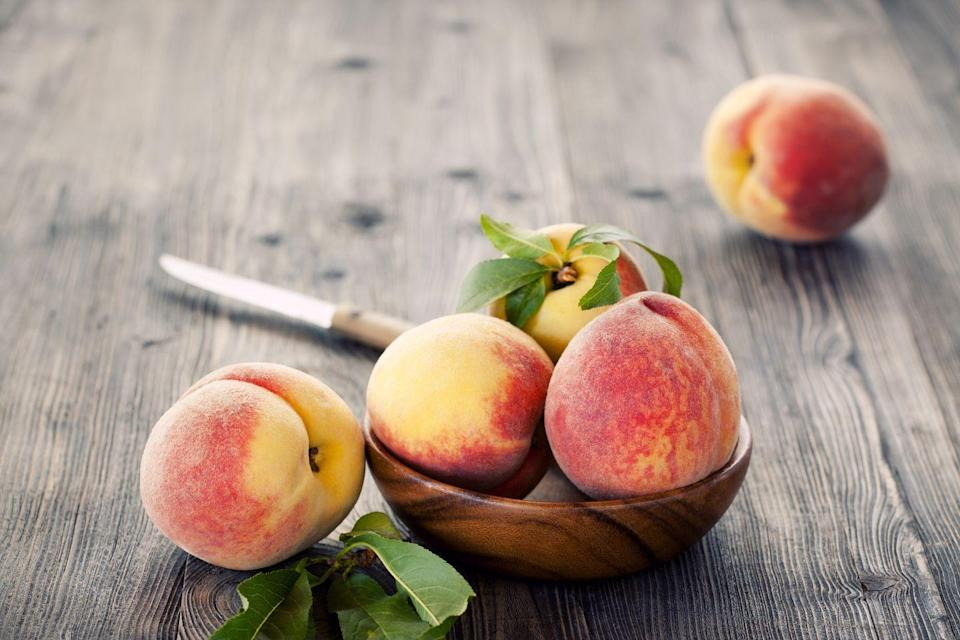"""<p>Nothing can beat the sweet and juicy flavor of a peach in season. Along with other stone fruits such as plums and nectarines, peaches contain bioactive compounds that <a href=""""https://www.sciencedaily.com/releases/2012/06/120618132921.htm"""" rel=""""nofollow noopener"""" target=""""_blank"""" data-ylk=""""slk:one study"""" class=""""link rapid-noclick-resp"""">one study</a> has found may fight obesity-related diabetes.</p><p><em>1 serving = 1 medium peach</em></p>"""