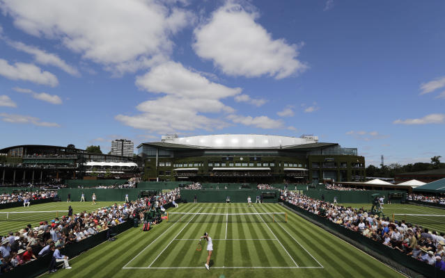 FILE - In this Monday, July 1, 2019, file photo, Russia's Margarita Gasparyan serves to Germany's Anna-Lena Friedsam during their women's singles match on day one of the Wimbledon Tennis Championships in London. (AP Photo/Ben Curtis, File)