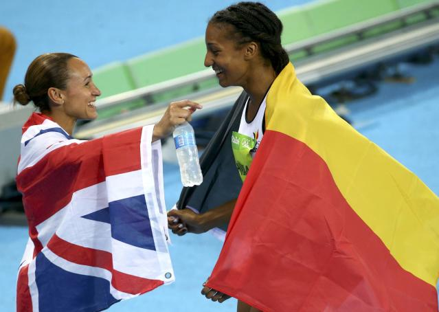 2016 Rio Olympics - Athletics - Final - Women's Heptathlon 800m - Olympic Stadium - Rio de Janeiro, Brazil - 13/08/2016. Jessica Ennis-Hill (GBR) of Britain and Nafissatou Thiam (BEL) of Belgium celebrate after the race REUTERS/David Gray FOR EDITORIAL USE ONLY. NOT FOR SALE FOR MARKETING OR ADVERTISING CAMPAIGNS.