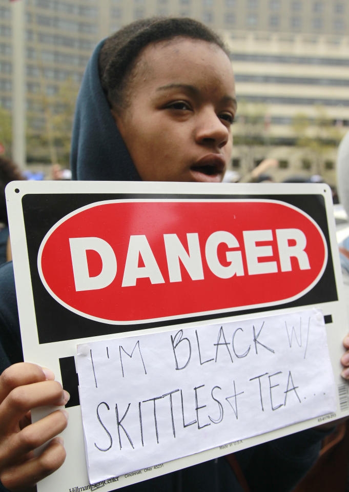 Zoe Guy, 15, of Cleveland, attends a rally demanding justice for Trayvon Martin in Freedom Plaza, Saturday, March 24, 2012, in Washington. Martin, an unarmed young black teen, was fatally shot by a volunteer neighborhood watchman. (AP Photo/Haraz N. Ghanbari)