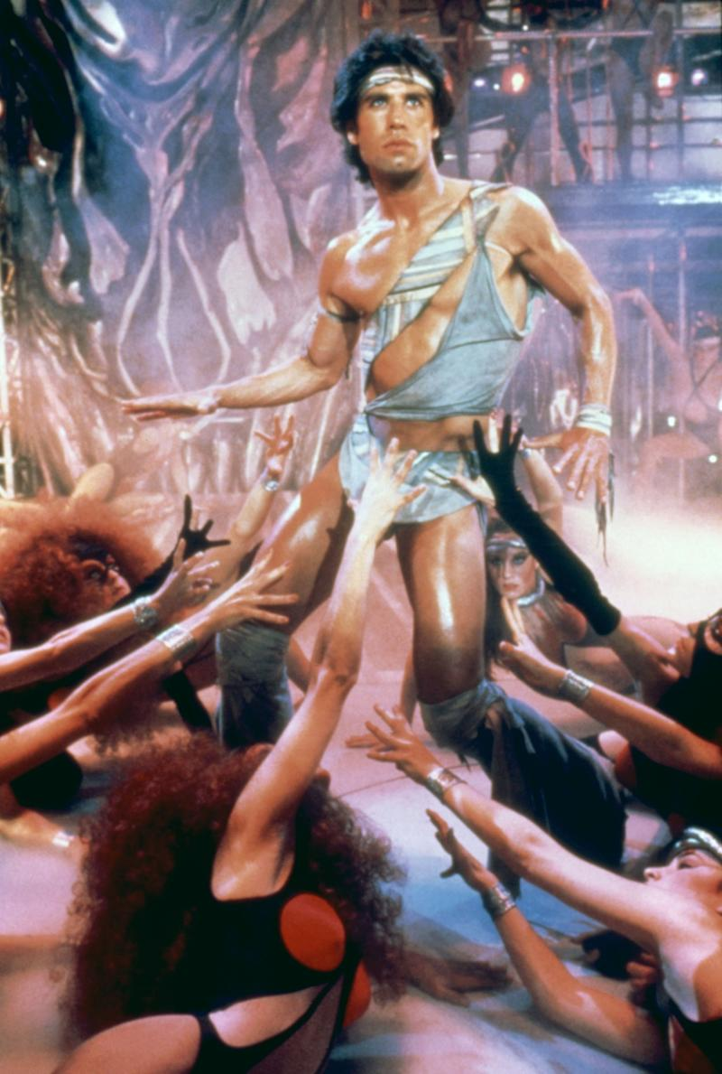 Staying Alive, 1983 Costume Designer: Tom Bronson The Sylvester Stallone–directed sequel to Saturday Night Fever defies logic on several points. Instead of hitting up the discos, John Travolta's Tony Manero now seeks Broadway success starring in Satan's Alley, a play that can only be described as a modern dance version of Dante's Inferno. If that weren't ridiculous enough, it all concludes with a loincloth-clad Travolta dancing through strobe lights while everyone else wears a combination of 1980s workout spandex and BDSM gear.