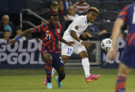 Martinique's Patrick Burner (17) clears the ball as United States' George Bello (21) pressures during the first half of a CONCACAF Gold Cup soccer match in Kansas City, Kan., Thursday, July 15, 2021. (AP Photo/Colin E. Braley)