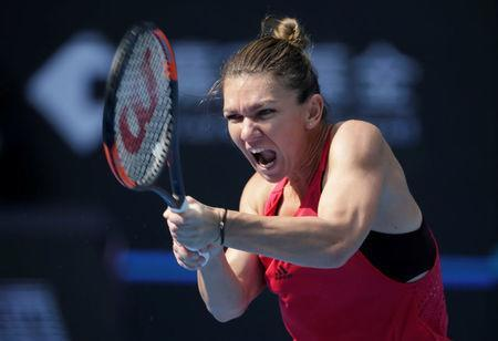 Tennis - China Open - Women's Singles Quarterfinals - Beijing, China - October 6, 2017 - Simona Halep of Romania in action against Daria Kasatkina of Russia. REUTERS/Jason Lee