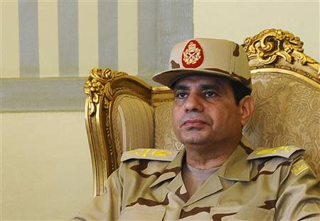 Egypt's Defense Minister Abdel Fattah al-Sisi is seen during a news conference in Cairo on the release of seven members of the Egyptian security forces kidnapped by Islamist militants in Sinai, in this May 22, 2013 file photo. REUTERS/Stringer
