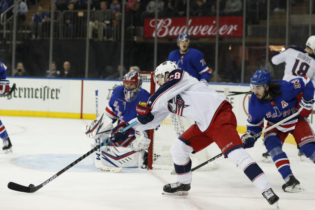Columbus Blue Jackets right wing Oliver Bjorkstrand (28) tries to shoot against New York Rangers goaltender Igor Shesterkin (31) with Rangers center Mika Zibanejad (93) defending during the first period of an NHL hockey game, Sunday, Jan. 19, 2020, in New York. (AP Photo/Kathy Willens)