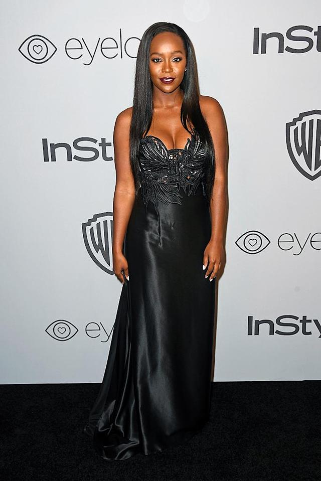<p><em>How to Get Away with Murder</em>'s Aja Naomi King attends the InStyle and Warner Bros. Pictures party. (Photo: Frazer Harrison/Getty Images) </p>