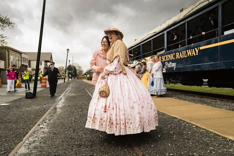 The Abes and Mary Lincolns attending the 25th annual Association of Lincoln Presenters conference take the train from Blue Ridge to McCaysville on April 12. Here, a Mary Lincoln poses for a photo. | Benjamin Norman for TIME