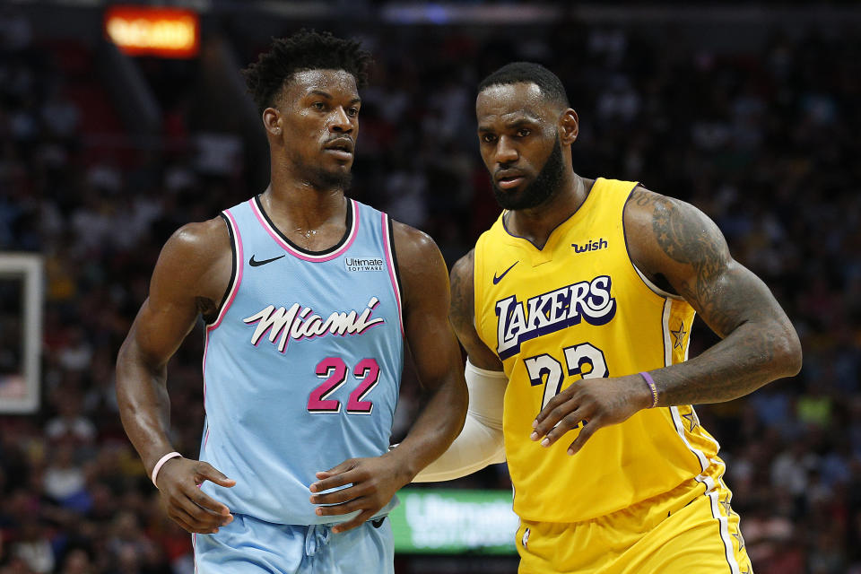 LeBron James (right) is looking to oust Jimmy Butler from the playoffs with a third different team. (Michael Reaves/Getty Images)