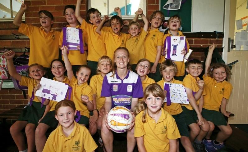 Perth Glory's women's team player and award winning school teacher Shannon May pictured with her supportive year 2 students at Kensington Primary School. Shannon will be playing in today's grand final. Picture: Lincoln Baker/The West Australian.