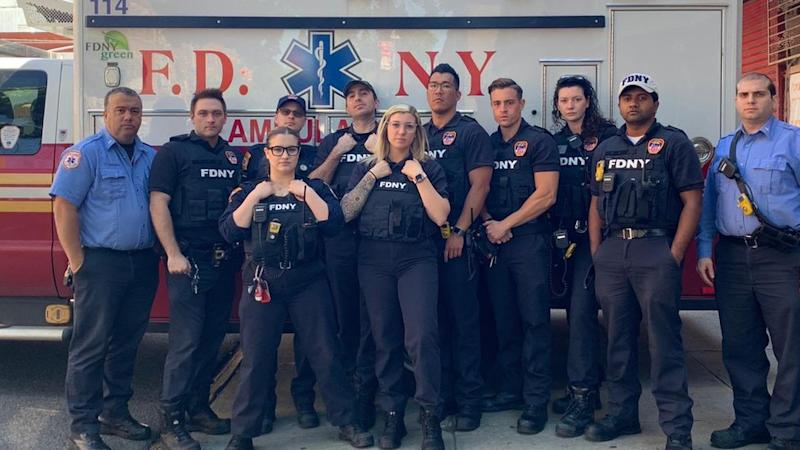 EMS crew pose in bullet-proof vests