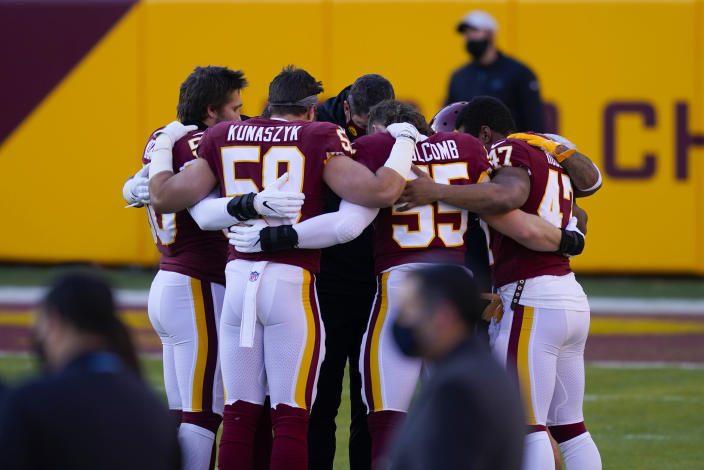 Members of the Washington Football Team huddle together before the start of an NFL football game against the Carolina Panthers, Sunday, Dec. 27, 2020, in Landover, Md. (AP Photo/Mark Tenally)