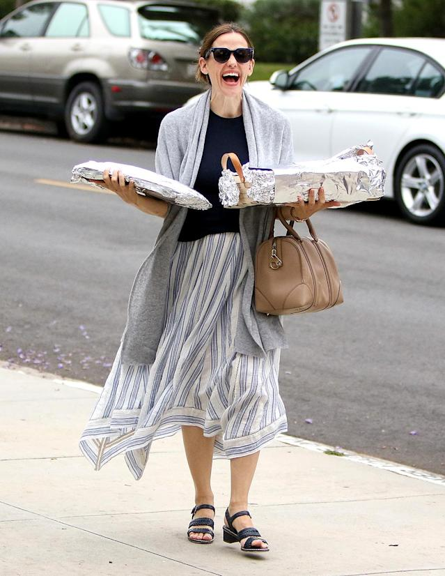 <p>No Hollywood here! Garner brought potluck dishes to church in L.A. on Sunday funday. (Photo: BG004/Bauer-Griffin/GC Images) </p>