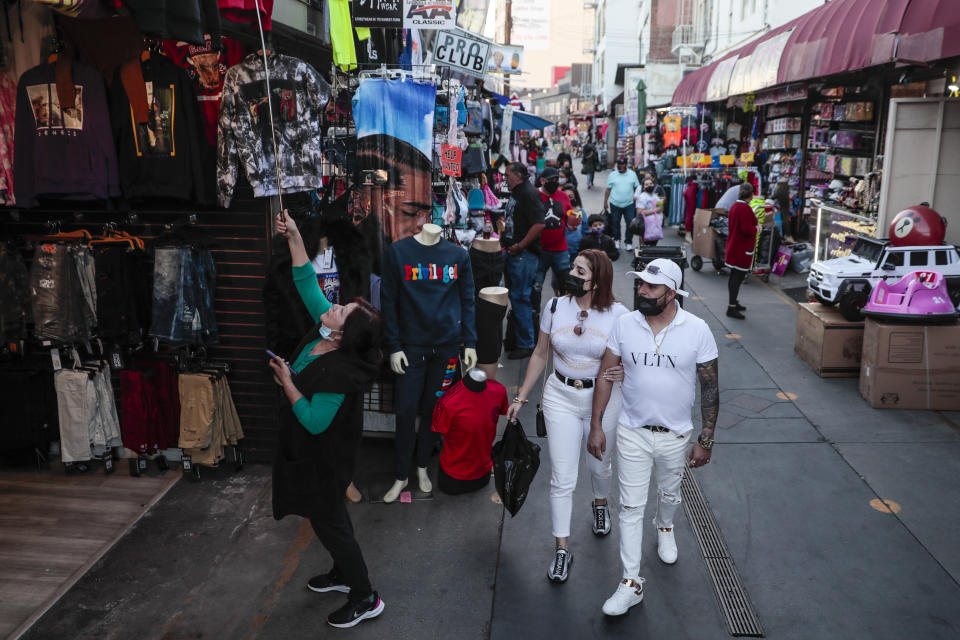 Los Angeles, CA, Friday, February 19, 2021 - Shoppers walk along Santee Alley late in the afternoon downtown.  (Robert Gauthier/Los Angeles Times via Getty Images)