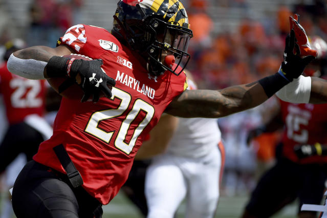 FILE - In this Sept. 7, 2019, file photo, Maryland running back Javon Leake (20) runs against Syracuse during the first half of an NCAA college football game, in College Park, Md. Leake was selected to The Associated Press All-Big Ten Conference team, Wednesday, Dec. 11, 2019. (AP Photo/Will Newton, File)