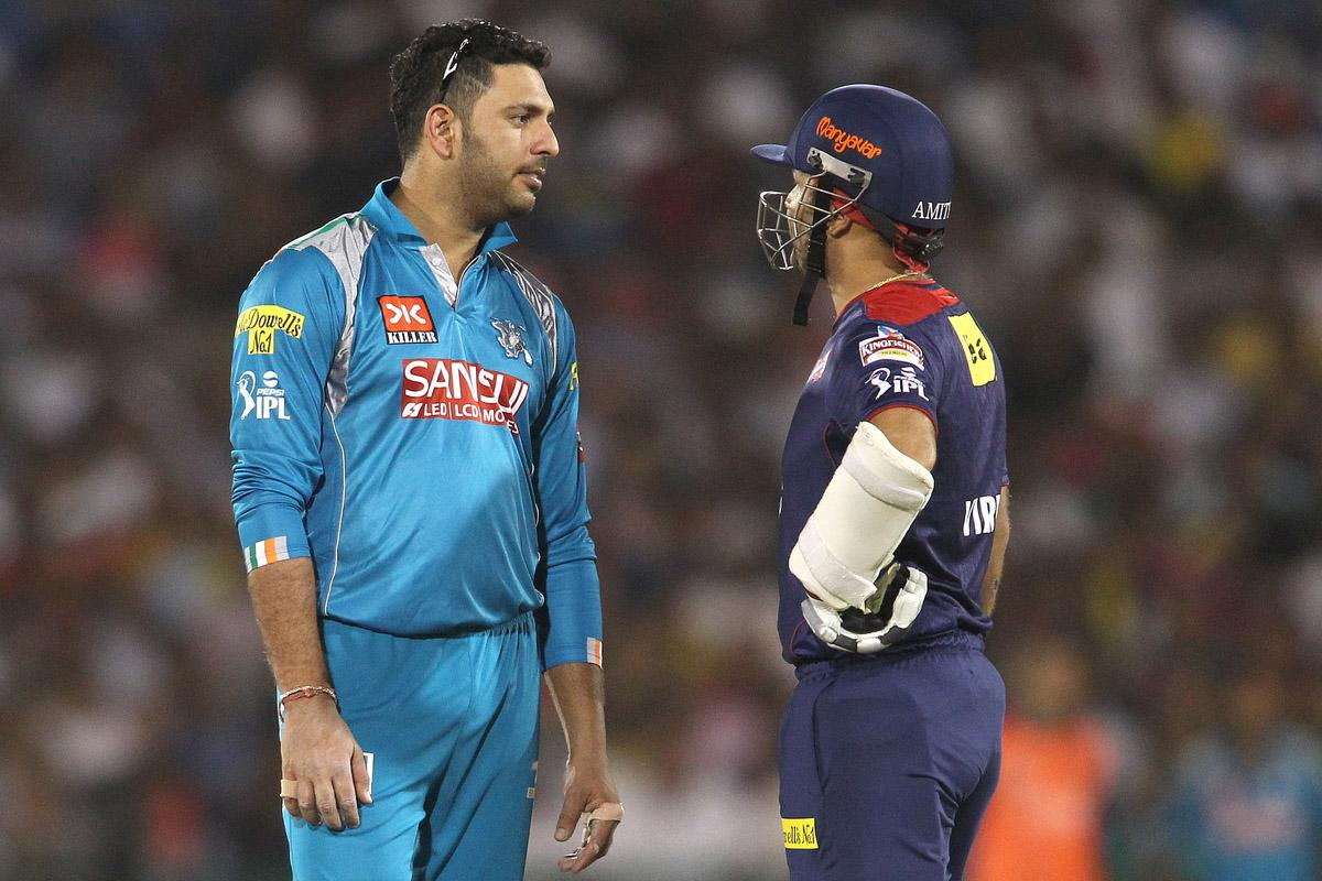 Yuvraj Singh of Pune Warriors India and Virender Sehwag of Delhi Daredevils chat during match 39 of the Pepsi Indian Premier League between The Delhi Daredevils and the Pune Warriors India held at the Chhattisgarh International Cricket Stadium in Raipur on the 28th April 2013. (BCCI)