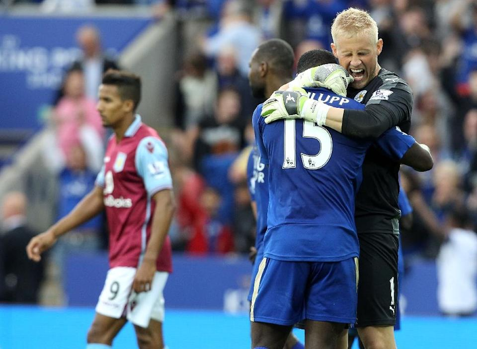 Leicester City's goalkeeper Kasper Schmeichel (R) celebrates with teammate Jeff Schlupp on the final whistle of their English Premier League match against Aston Villa, at King Power Stadium in Leicester, on September 13, 2015 (AFP Photo/Lindsey Parnaby)
