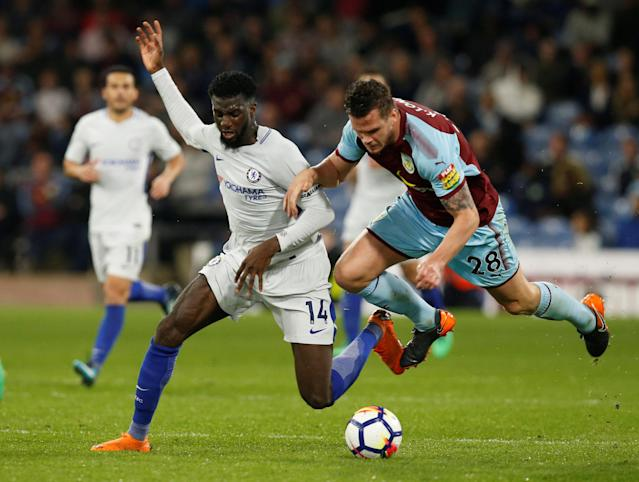 "Soccer Football - Premier League - Burnley vs Chelsea - Turf Moor, Burnley, Britain - April 19, 2018 Chelsea's Tiemoue Bakayoko in action with Burnley's Kevin Long REUTERS/Andrew Yates EDITORIAL USE ONLY. No use with unauthorized audio, video, data, fixture lists, club/league logos or ""live"" services. Online in-match use limited to 75 images, no video emulation. No use in betting, games or single club/league/player publications. Please contact your account representative for further details."
