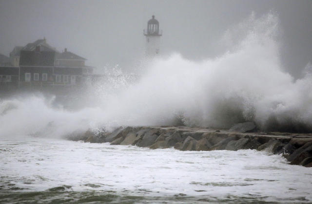 <p>Waves crash against a seawall near the Scituate Lighthouse, Friday, March 2, 2018, in Scituate, Mass. (Photo: Steven Senne/AP) </p>