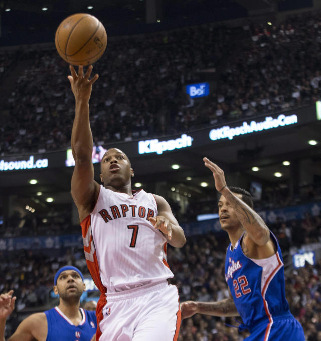 Toronto Raptors' Kyle Lowry drives through the Los Angeles Clippers defense to shoot during the first half of an NBA basketball game, Saturday, Jan. 25, 2014 in Toronto. (AP Photo/The Canadian Press, Chris Young)