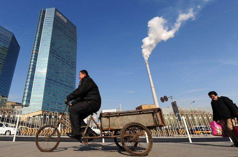 A cloud of smoke curls from the chimney of a coal-fired power plant in Beijing on December 16, 2009. Coal is set to surpass oil as the world's top fuel within a decade, driven by growth in emerging market giants China and India, with even Europe finding it hard to cut use despite pollution concerns, according to a report published Tuesday