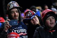 Supporters watch as President Trump addresses a crowd in Pennsylvania on Saturday