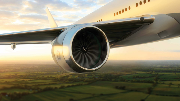 A GE9X engine mounted on the wing of a plane.