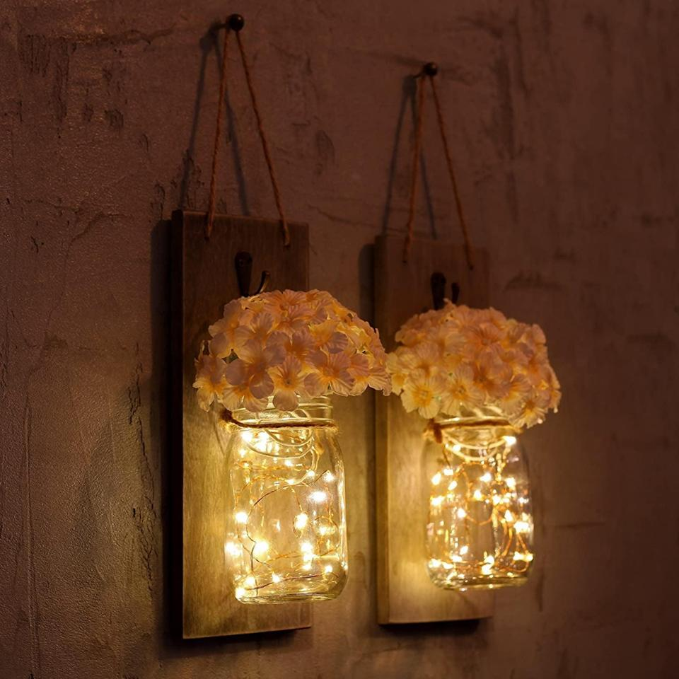 <p>These <span>Rustic Mason Jars Wall Sconces</span> ($23) would look great in your living room.</p>