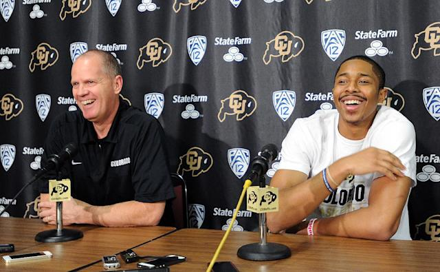 Colorado head coach Tad Boyle, left, joins Spencer Dinwiddie at a news conference on Thursday, April 24, 2014, in Boulder, Colo. Dinwiddie announced that he is skipping his senior season and will declare for the NBA draft. (AP Photo/The Daily Camera, Cliff Grassmick)