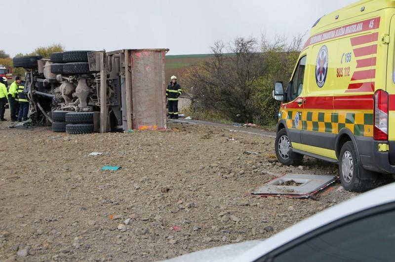 Rescue workers are seen at the site of a bus crash near the city of Nitra