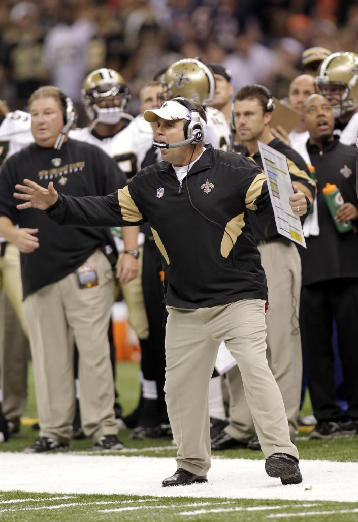 FILE - In this Sept. 18, 2011 file photo, New Orleans Saints head coach Sean Payton yells on the sideline during an NFL football game against the Chicago Bears at the Louisiana Superdome in New Orleans. he NFL has suspended Payton for the 2012 season, and former Saints defensive coordinator Gregg Williams is banned from the league indefinitely because of the team's bounty program that targeted opposing players. Also Wednesday, March 21, 2012, Goodell suspended Saints general manager Mickey Loomis for the first eight regular-season games of 2012, and assistant coach Joe Vitt has to sit out the first six games. (AP Photo/Bill Haber, File)