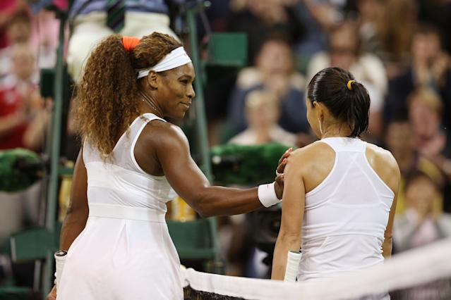 LONDON, ENGLAND - JUNE 29: Serena Williams of the United States of America shakes hands at the net with Kimiko Date-Krumm of Japan after their Ladies' Singles third round match on day six of the Wimbledon Lawn Tennis Championships at the All England Lawn Tennis and Croquet Club on June 29, 2013 in London, England. (Photo by Clive Brunskill/Getty Images)