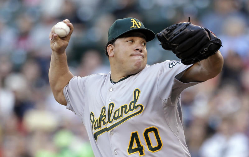 Oakland Athletics starting pitcher Bartolo Colon throws against the Seattle Mariners in the first inning of a baseball game on Friday, June 21, 2013, in Seattle. (AP Photo/Elaine Thompson)