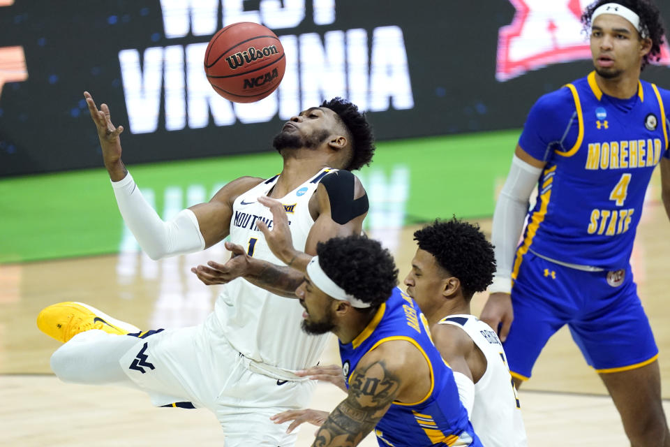 West Virginia's Derek Culver (1) battles for a rebound against Morehead State during the first half of a college basketball game in the first round of the NCAA tournament at Lucas Oil Stadium Friday, March 19, 2021, in Indianapolis. (AP Photo/Mark Humphrey)