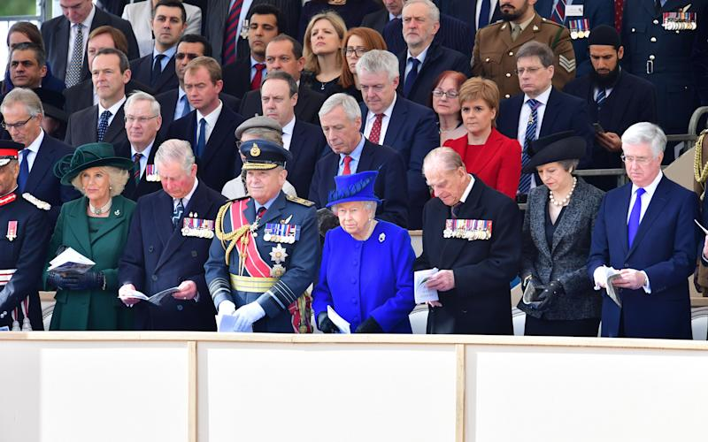 The Queen leads guests at the memorial service - Credit: Rex