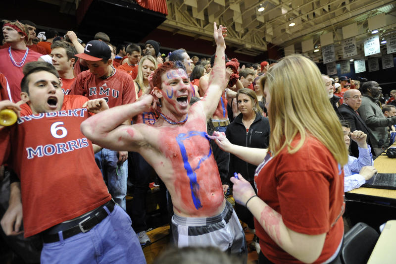 Robert Morris fans cheer as their team takes the court to warm up before an NIT college basketball game against Kentucky on Tuesday, March 19, 2013, in Coraopolis, PA. (AP Photo/Don Wright)