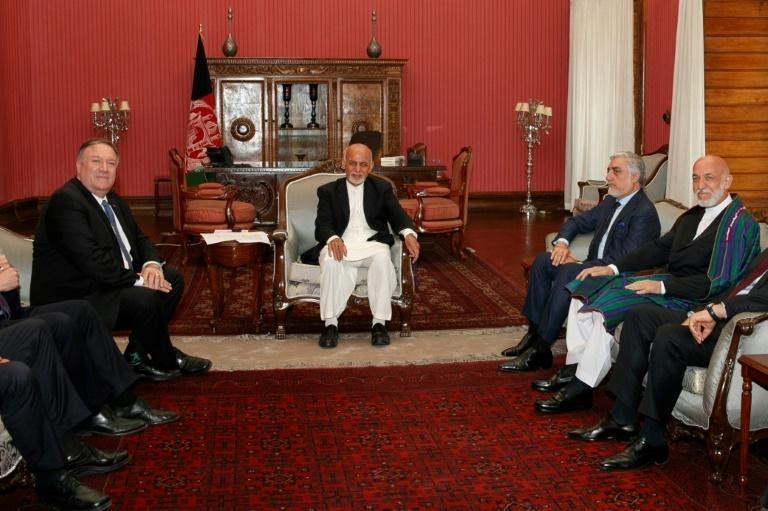 Secretary of State Mike Pompeo (left) meets with Afghan President Ashraf Ghani (center) and Afghan Chief Executive Officer Abdullah Abdullah (right) on a July 2019 visit to Kabul (AFP Photo/Jacquelyn Martin)