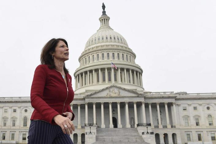 FILE - In this Jan. 4, 2019 file photo, Rep. Cheri Bustos, D-Ill., walks to a group photo with the women of the 116th Congress on Capitol Hill in Washington. A mass departure of top aides is shaking House Democrats' campaign arm after Hispanic and black members of Congress complained that the staff lacked diversity. Illinois Rep. Cheri Bustos is chairwoman of the Democratic Congressional Campaign Committee. She's issued a statement saying she'd 'fallen short' and would work to make the staff 'truly inclusive.' (AP Photo/Susan Walsh)