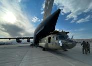 A CH-47 Chinook is loaded onto a U.S. Air Force C-17 Globemaster III at Hamid Karzai International Airport in Kabul