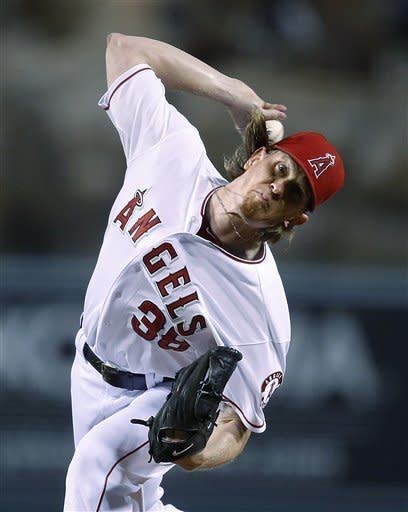 Los Angeles Angels starting pitcher Jered Weaver throws to aTexas Rangers batter during the first inning of a baseball game in Anaheim, Calif., Tuesday, Sept. 18, 2012. (AP Photo/Jae C. Hong)