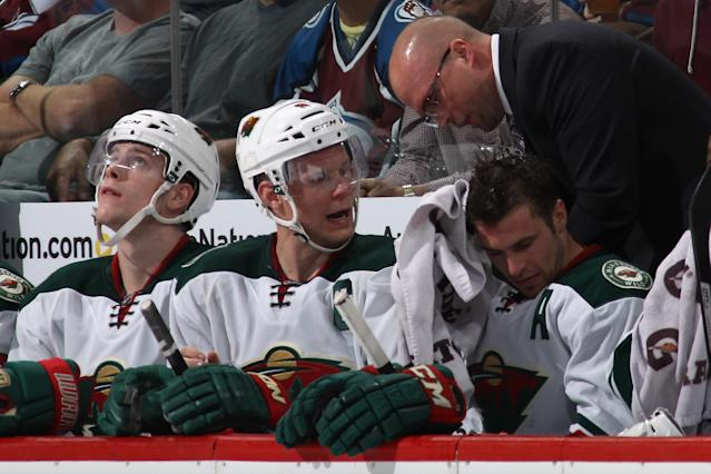 DENVER, CO - APRIL 19: Head coach Mike Yeo of the Minnesota Wild talks with Mikko Koivu #9 of the Minnesota Wild on the bench as they face the Colorado Avalanche in Game Two of the First Round of the 2014 NHL Stanley Cup Playoffs at Pepsi Center on April 19, 2014 in Denver, Colorado. The Avalanche defeated the Wild 4-2 to take a 2-0 game lead in the series. (Photo by Doug Pensinger/Getty Images)