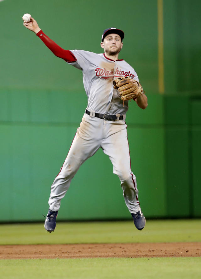 Washington Nationals shortstop Trea Turner throws to first to put out Miami Marlins' Austin Dean during the ninth inning of a baseball game, Tuesday, Sept. 18, 2018, in Miami. The Nationals defeated the Marlins 4-2. (AP Photo/Wilfredo Lee)