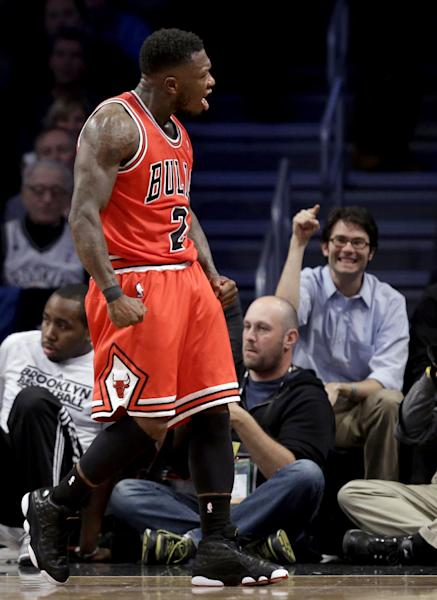 Chicago Bulls guard Nate Robinson (2) reacts after scoring in the first half of Game 5 of their first-round NBA basketball playoff series against the Brooklyn Nets, Monday, April 29, 2013, in New York. (AP Photo/Kathy Willens)