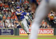 With the bases loaded and two out, Texas Rangers third baseman Nick Solak fields the hit by Houston Astros George Springer to first base for the out to end the second inning of a baseball game Wednesday, Sept. 18, 2019, in Houston. (AP Photo/Michael Wyke)