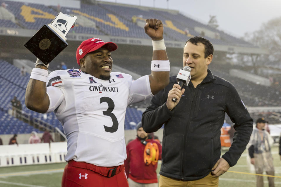 Cincinnati Bearcats RB Michael Warren II (3) receives the player of the game trophy after the game against the Virginia Tech Hokies. (Photo: USA Today)