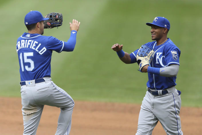 Kansas City Royals' Whit Merrifield (15) celebrates with teammate Edward Olivares after their win over the Minnesota Twins during a baseball game Sunday, May 30, 2021, in Minneapolis. (AP Photo/Stacy Bengs)