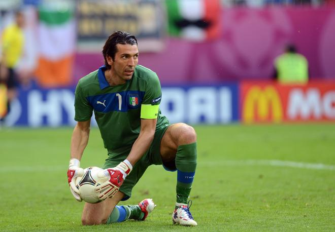 Italian goalkeeper Gianluigi Buffon grabs the ball during the Euro 2012 championships football match Spain vs Italy on June 10, 2012 at the Gdansk Arena.      AFP PHOTO / CHRISTOF STACHECHRISTOF STACHE/AFP/GettyImages