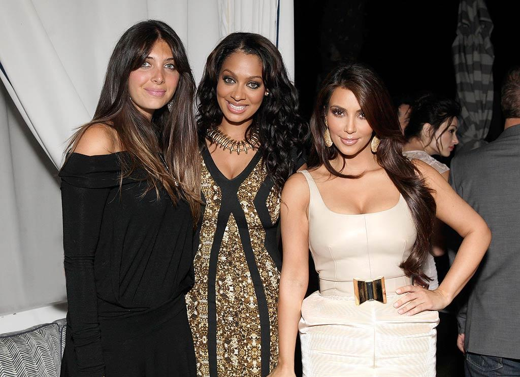 """The curvaceous Kim, wearing a Hannah Marshall leather top and corduroy skirt accessorized with strappy Christian Louboutin heels, mingled with BFFs Brittny Gastineau and La La Vazquez. Todd Williamson/<a href=""""http://www.wireimage.com"""" target=""""new"""">WireImage.com</a> - August 25, 2010"""