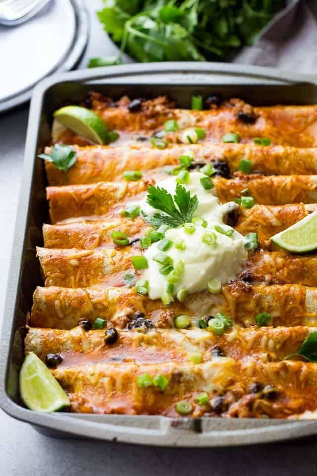 """<p>Say hello to your new favorite one-pot dinner.</p><p>Get the recipe from <a href=""""https://diethood.com/ground-turkey-black-bean-enchiladas/"""" rel=""""nofollow noopener"""" target=""""_blank"""" data-ylk=""""slk:Diethood"""" class=""""link rapid-noclick-resp"""">Diethood</a>.</p>"""