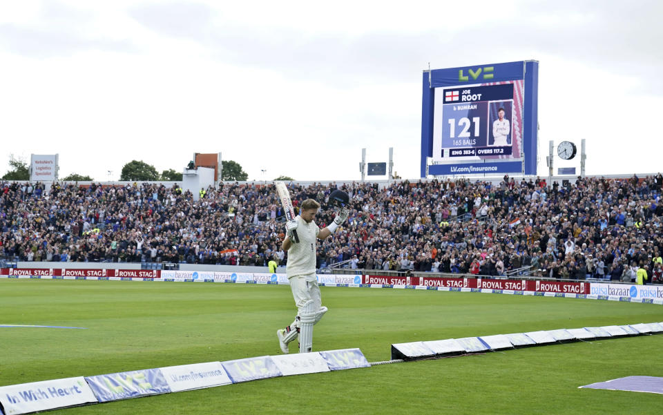 England captain Joe Root acknowledges the applause from the crowd as he walks off the field after losing his wicket during the second day of third test cricket match between England and India, at Headingley cricket ground in Leeds, England, Thursday, Aug. 26, 2021. (AP Photo/Jon Super)