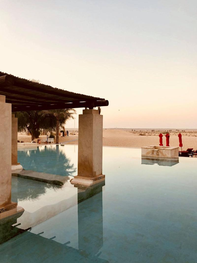 The hotel's pool boasts spectacular views of the Dubai desert.